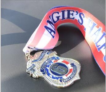 Angie's Half Crazy Half Marathon 4-7-13 medal